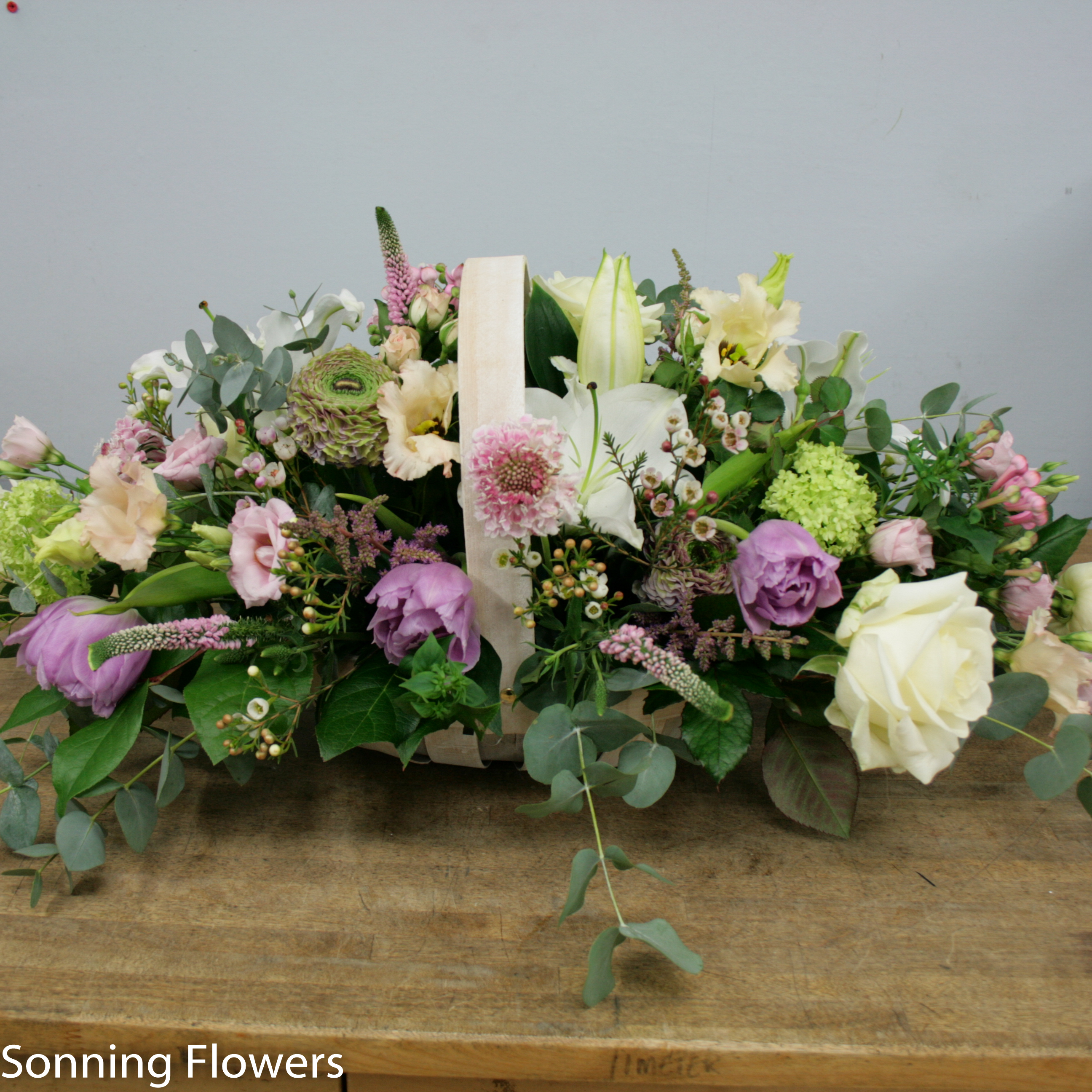 Basket of flowers funeral tribute sonning flowers basket funeral flowers izmirmasajfo